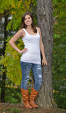 Beautiful young woman in tank top and jeans Royalty Free Stock Photos