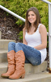 Beautiful young woman in tank top and jeans Royalty Free Stock Photo