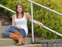 Beautiful young woman in tank top and jeans Stock Photo