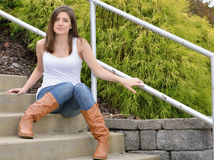 Beautiful young woman in tank top and jeans Stock Image