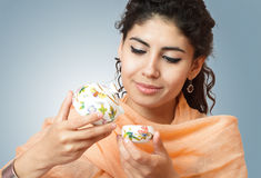 Beautiful young woman with tea Royalty Free Stock Image