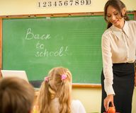 Beautiful young woman teacher Stock Photo