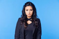 The offended girl in a black jacket shows did pucker royalty free stock photo