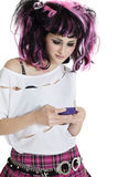 Beautiful young woman text messaging over white background Royalty Free Stock Image