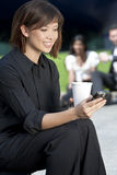 Beautiful Young Woman Texting Royalty Free Stock Images
