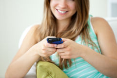 Beautiful young woman texting with her cellphone Royalty Free Stock Images