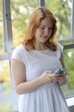 Beautiful Young Woman Texting on Her Phone Stock Photos