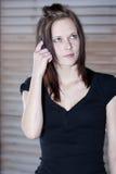 Beautiful young woman thinking Stock Photography