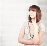 Beautiful young woman thinking Royalty Free Stock Image