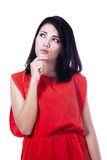Beautiful young woman with a thinking expression Royalty Free Stock Photography
