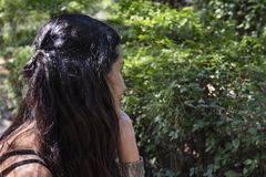 Beautiful young woman thinking in the park. royalty free stock photos