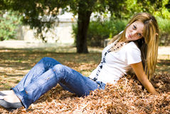 Beautiful young woman throwing leaves Royalty Free Stock Image