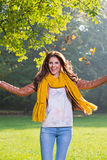 Beautiful young woman throwing leaves Royalty Free Stock Photography