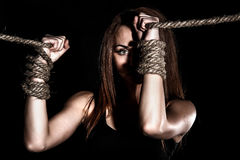 Beautiful young woman with tied arms Stock Photo