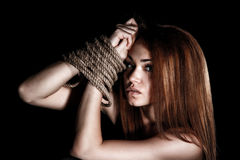 Beautiful young woman with tied arms Royalty Free Stock Photos