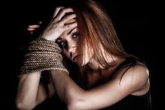 Beautiful young woman with tied arms Stock Image