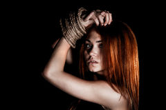 Beautiful young woman with tied arms royalty free stock photo