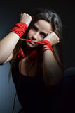 Beautiful young woman tied with the red rope Royalty Free Stock Photos