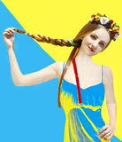 Beautiful young woman to keep her hair blue and yellow background Stock Image