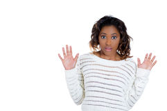 A beautiful young woman in total disbelief, arms in the air Royalty Free Stock Photography