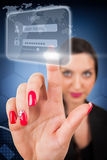 Beautiful woman touching a digital screen Stock Image