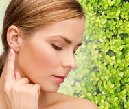 Beautiful young woman touching her ear Royalty Free Stock Photography