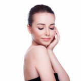 Beautiful Young Woman Touching Her Face. Royalty Free Stock Images