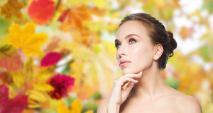 Beautiful young woman touching her face Royalty Free Stock Photos