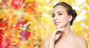 Beautiful young woman touching her face Stock Photography