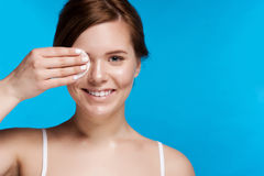 Beautiful Young Woman Touching Her Face.Fresh Healthy Skin. on Blue Royalty Free Stock Photo
