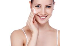 Beautiful Young Woman Touching Her Face.Fresh. Healthy Skin.Isolated on White royalty free stock photography