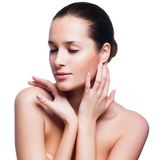 Beautiful Young Woman Touching Her Face. Royalty Free Stock Image