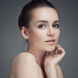 Beautiful Young Woman Touching Her Face.Fresh Healthy Skin.Isolated Stock Photography