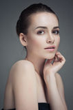 Beautiful Young Woman Touching Her Face.Fresh Healthy Skin.Isolated Royalty Free Stock Images