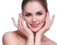 Beautiful Young Woman Touching Her Face.Fresh Healthy Skin.Isolated on White Royalty Free Stock Photography
