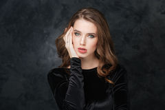 Beautiful young woman touching her face by hand Royalty Free Stock Photography