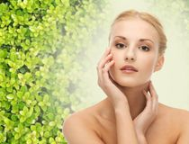 Beautiful young woman touching her face skin Royalty Free Stock Image