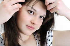 Beautiful young woman touching her hair Royalty Free Stock Photo