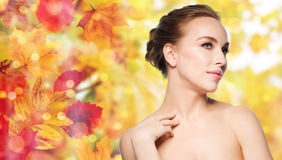 Beautiful young woman touching her neck Royalty Free Stock Images