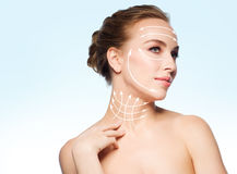 Beautiful young woman touching her neck. Beauty, people, plastic surgery, anti-age and health concept - beautiful young woman touching her neck over blue Stock Photography