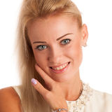 Beautiful young woman touching skin on her face Royalty Free Stock Photos