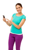 Beautiful Young Woman Touching Smart Phone Royalty Free Stock Photography