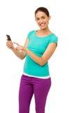 Beautiful Young Woman Touching Smart Phone Royalty Free Stock Photography