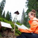 Beautiful young woman tourist looking at map Stock Photos