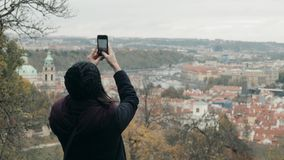 Beautiful Young Woman Tourist In Prague, Making Selfie or Taking Photo With Her Mobile Phone, Travelling Concept. 4K stock video footage