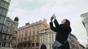 Beautiful Young Woman Tourist In Prague, Making Selfie or Taking Photo With Her Mobile Phone, Travelling Concept. 4K stock footage