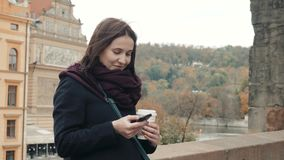Beautiful Young Woman Tourist In Prague Using Her Smartphone, Travelling Concept. 4K stock video footage