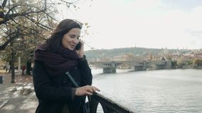 Beautiful Young Woman Tourist In Prague Using Her Smartphone, Travelling Concept. 4K stock video
