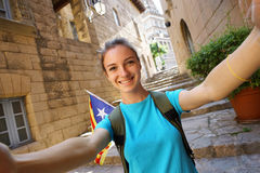 Beautiful Young Woman tourist taking selfie pictures  during Europe travel. Hiking by the streets of Valencia, Spain Royalty Free Stock Images