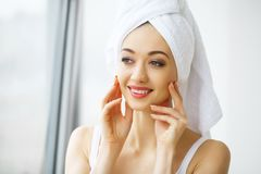 Beautiful young woman in towel all ready to get spa treatment. g Royalty Free Stock Images